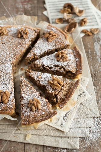 Nut cake dusted with icing sugar, sliced
