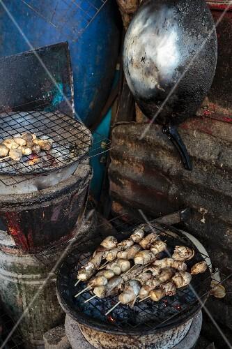 Straw mushrooms on a rustic barbecue, Bangkok, Thailand