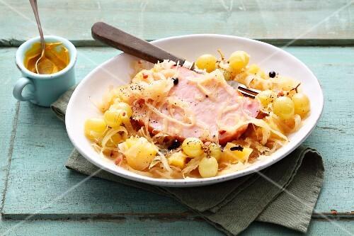 Sauerkraut stew with smoked pork, potatoes and grapes