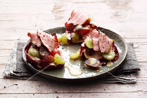 Grape salad with duck on radicchio leaves