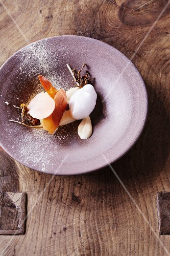 Coltsfoot ice cream with parsnips and vinegar foam at the restaurant Oaxen Krog run by chef Magnus Ek, Stockholm