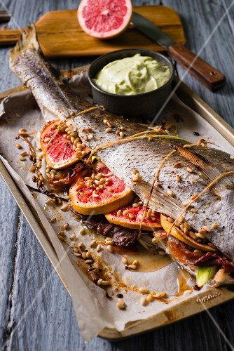 Stuffed cod with ham and grapefruit