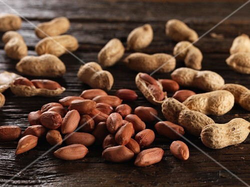 Peanuts on a wooden surface