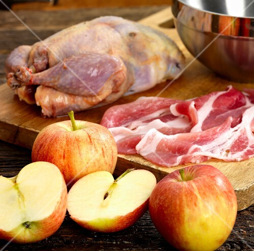 Ingredients for roast pheasant with apple and bacon