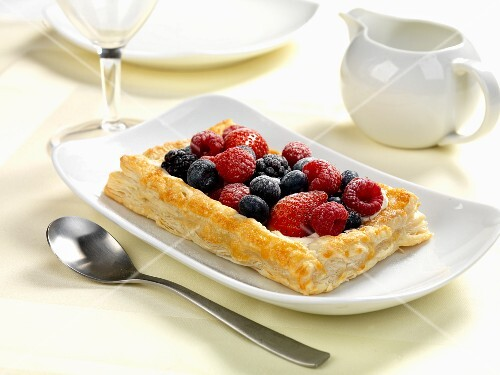 A summer fruits pasty served with cream