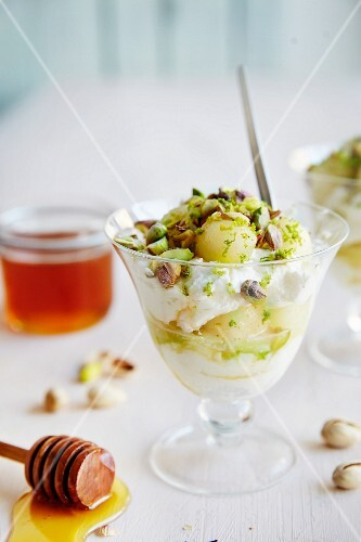 Greek yoghurt with honey, melons and pistachio nuts