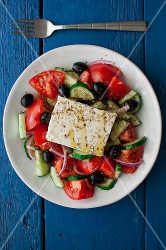 Greek salad with tomatoes, cucumber, onions, black olives, feta cheese, olive oil and dried oregano