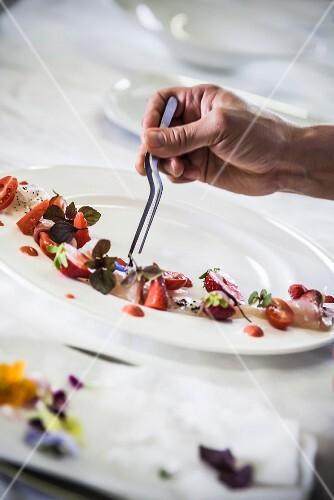 A chef arranging a desert