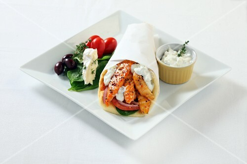A wrap with smoked fish, crème fraîche and a side salad