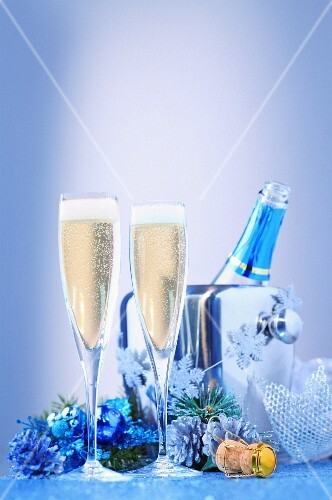 A Christmas arrangement of champagne with glasses and a cooler