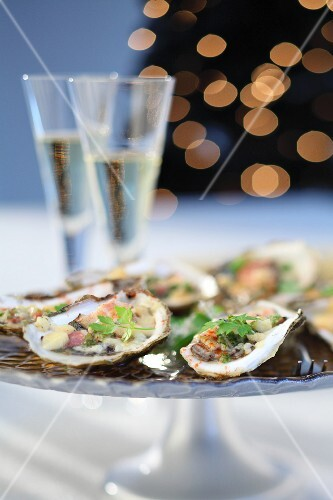 Oysters on a festive platter served with champagne