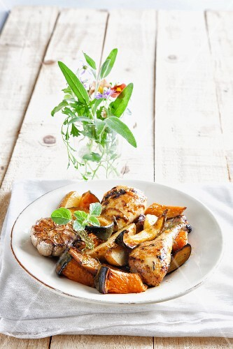 Orange chicken with oven roasted vegetables and herbs