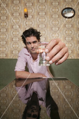 A man toasting with a shot glass