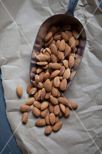 A scoop of almonds on a piece of paper