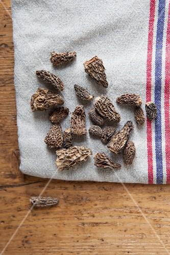 Dried morel mushrooms on a tea towel