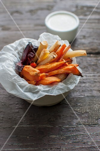 Beetroot, sweet potato and parsley root sticks with a horseradish and yoghurt sauce