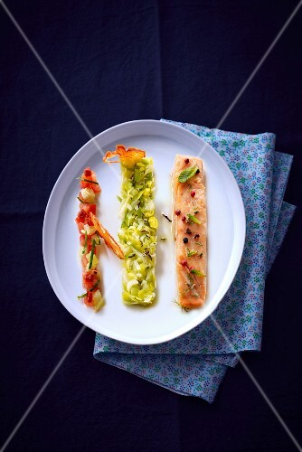 Poached salmon with a side of vegetables