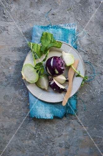 Green and purple kohlrabi on a plate
