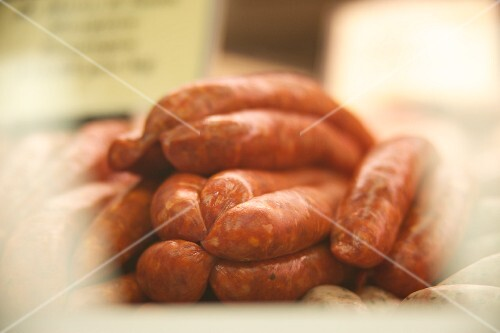 Raw sausages in a butcher's
