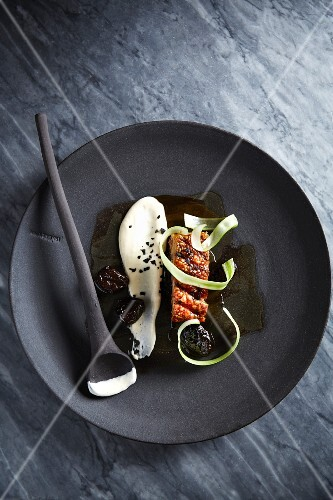 Pork belly with mashed celery and whiskey plums