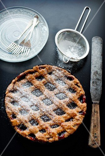 Homemade Linz tart with icing sugar