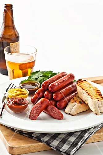 Sausages with grilled bread, sauces and beer