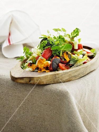 An autumnal vegetable salad with pumpkin