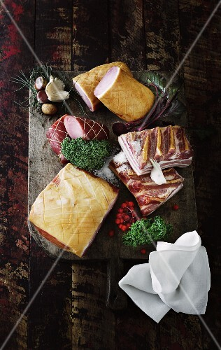 An arrangement of pork meat and sausages