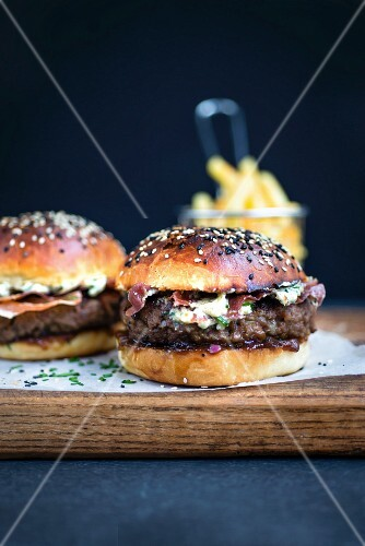 Blue cheese burgers on brioche buns with pancetta