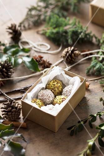 Vanilla truffles with pistachios nuts, coconut and homemade vanilla extract