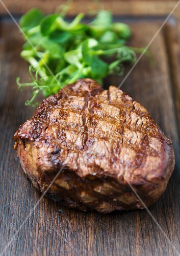 Grilled beef steak on a wooden board