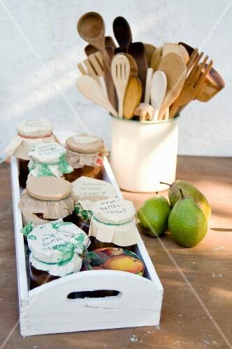 Grandma's recipe: jars of homemade pear and onion chutney on a tray