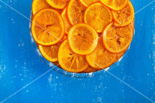 Orange cake on a blue surface (see from above)