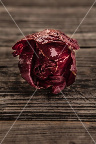 Fresh radicchio on an old wooden table