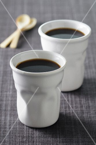 Black coffee into ceramic cups