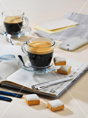Coffee and cakes on a notebook