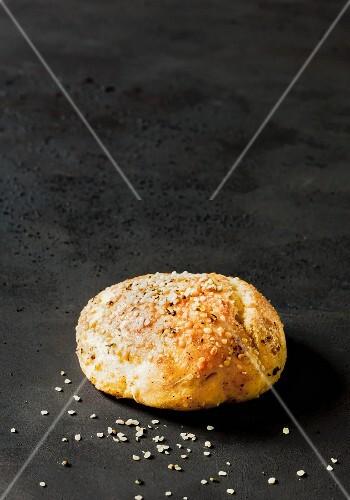 A burger bun with hemp seeds