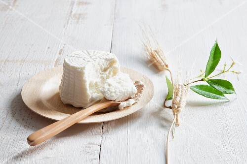 Ricotta on a plate with a wooden spoon