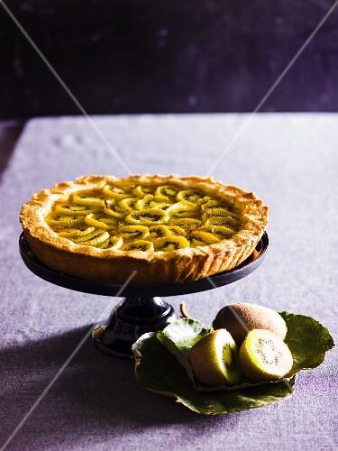 Kiwi pie on a cake stand