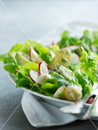 A mixed leaf salad with potatoes and avocado