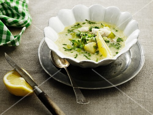 Fish soup with chives and lemon
