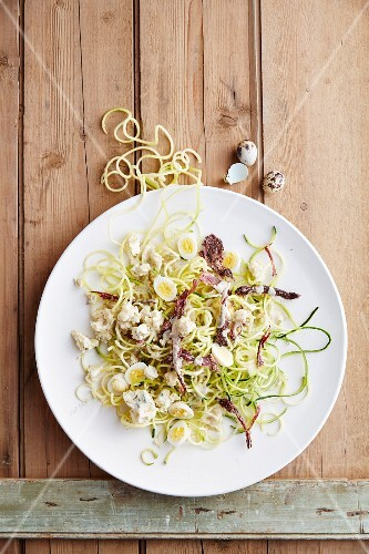 Courgette salad with quail's eggs, ostrich biltong, blue cheese and a white wine dressing (South Africa)