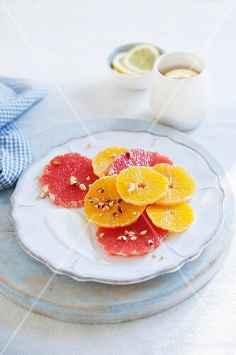 Citrus salad with pink grapefruit, oranges, nuts and yoghurt