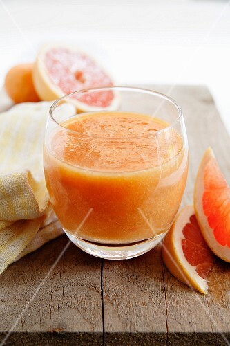 A glass of pink grapefruit and orange juice