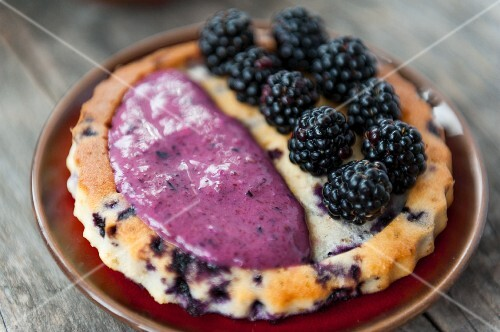 Blackberry tart with blueberry sauce