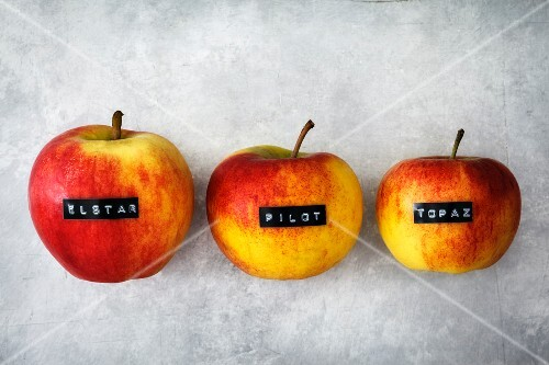 Three apples: Elstar, Pilot and Topaz (seen from above)