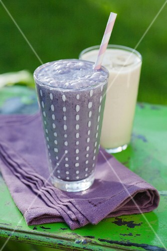 A blueberry and oat smoothie and a banana smoothie