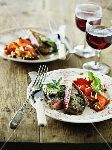 Beef steak with herb butter and a red pepper medley