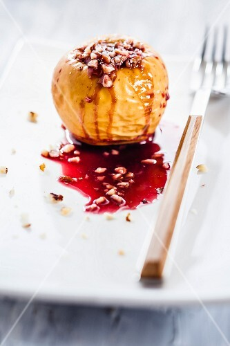 A baked apple filled with nuts and redcurrant jelly