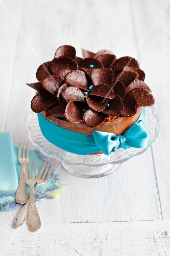 A festive chocolate cake decorated with chocolate thins